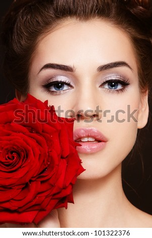 Portrait of young beautiful stylish woman with gorgeous red rose - stock photo