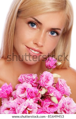 Portrait of young beautiful tanned blond smiling girl with pink flowers - stock photo