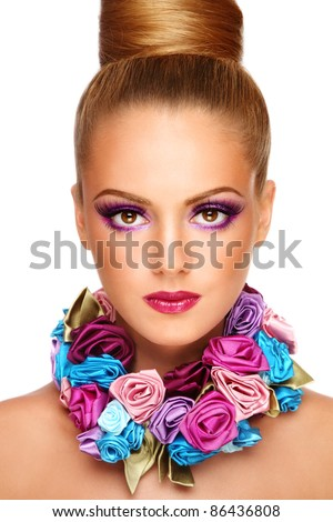 Portrait of young beautiful tanned girl with stylish violet make-up and fancy necklace, on white background - stock photo