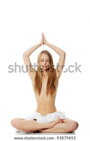 Portrait of young beautiful topless caucasian woman with towel on her waist practicing yoga, isolated on white background - stock photo