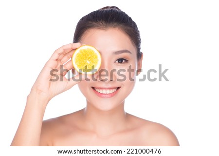 portrait of young beautiful woman being treated. Beautiful woman face with juicy orange - isolated on white  - stock photo