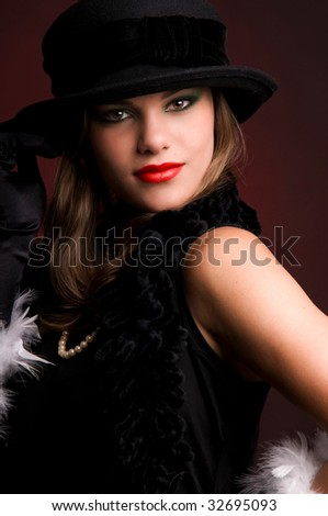 Portrait of young beautiful woman in a hat.