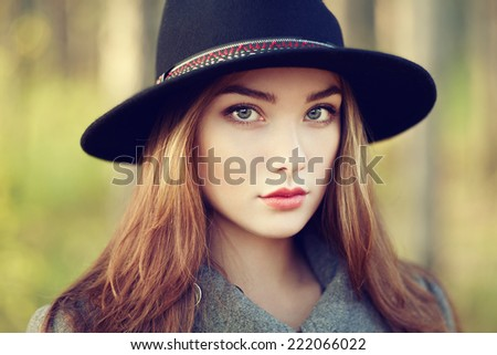 Portrait of young beautiful woman in autumn coat. Girl in hat. Fashion photo - stock photo