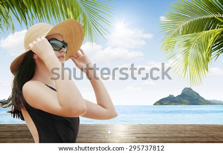 portrait of young beautiful woman in hat and sunglasses - stock photo