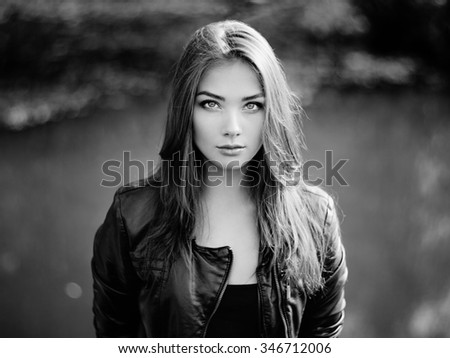 Portrait of young beautiful woman in leather jacket. Fashion photo - stock photo