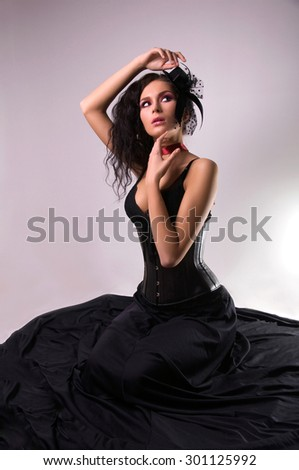 Portrait of young beautiful woman in little hat. - stock photo