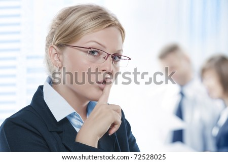 Portrait of young beautiful woman in office environment - stock photo