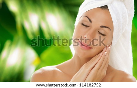 portrait of young beautiful woman  in spa environment - stock photo