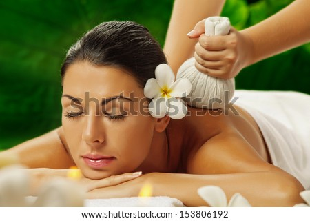 portrait of young beautiful woman in spa environment