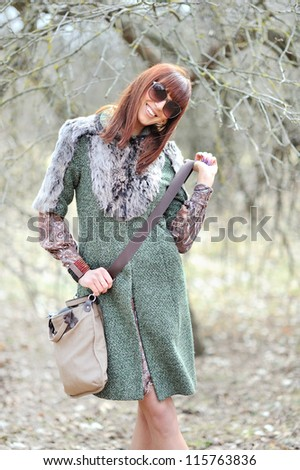 Portrait of young beautiful woman in sunglasses with shopping bag - stock photo