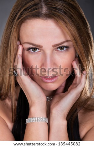 Portrait Of Young Beautiful Woman Isolated Over Colored Background