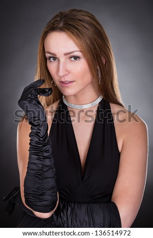 Portrait Of Young Beautiful Woman Isolated Over Colored Background - stock photo