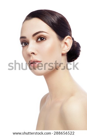 Portrait of young beautiful woman looking upwards over white background - stock photo