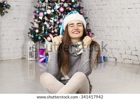 Portrait of young beautiful woman near new year tree - stock photo