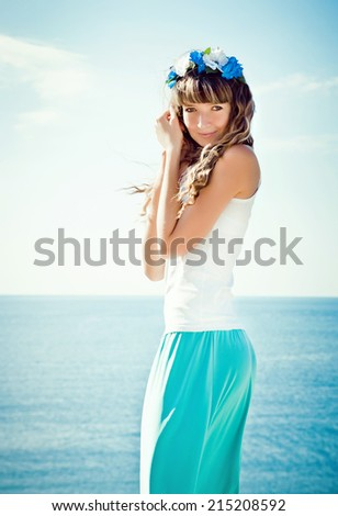 portrait of young beautiful woman near the sea