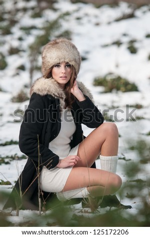 Portrait of young beautiful woman outdoor.Beautiful brunette girl in winter clothes.young woman wearing coat walking down the street, cold winter day.Beauty woman in the winter scenery - stock photo