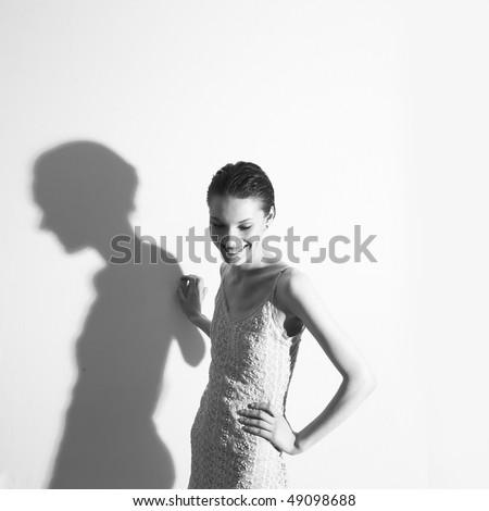 Portrait of young beautiful woman. Studio photo - stock photo