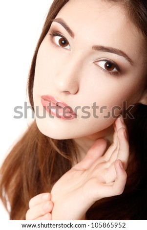 portrait of young beautiful woman touching with hand her face. isolated on white background.