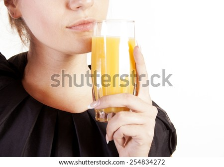 Portrait of young beautiful woman with a glass of juice - stock photo