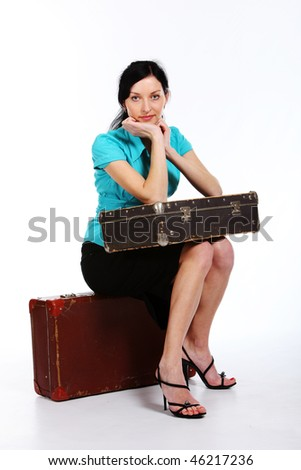 portrait of  young beautiful woman with an old suitcase