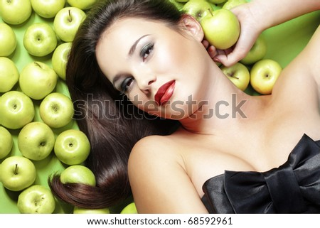 Portrait of young beautiful woman with apples - stock photo