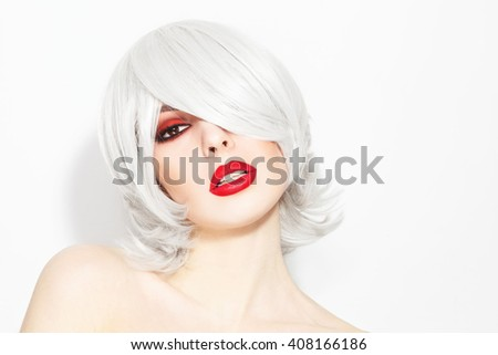 Portrait of young beautiful woman with choppy lob with fringe and stylish make-up - stock photo
