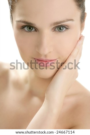 Portrait of young beautiful woman with clean skin at studio