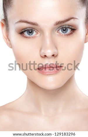 portrait of young beautiful woman with clean skin. On white background - stock photo