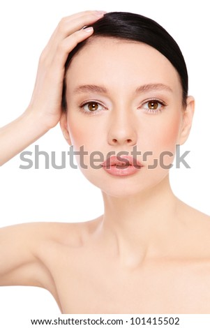 Portrait of young beautiful woman with clear make-up over white background