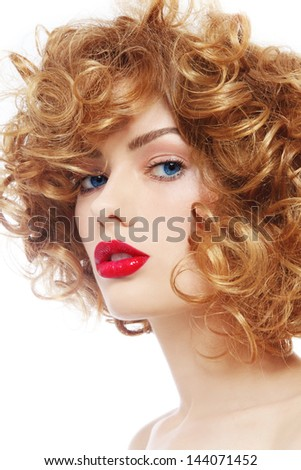 Portrait of young beautiful woman with curly hair and red lipstick over white background - stock photo