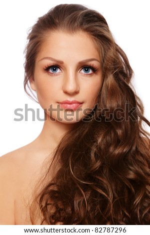 Portrait of young beautiful woman with healthy curly long hair, on white background - stock photo