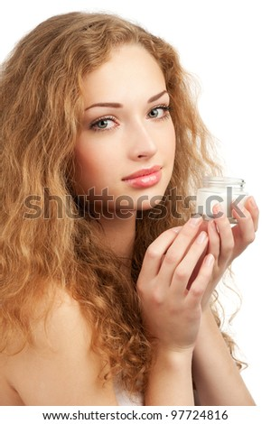 Portrait of young beautiful woman with jar of moisturizing cream for face or body, isolated on white background - stock photo