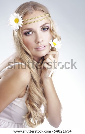 Portrait of young beautiful woman with long blond hair - stock photo