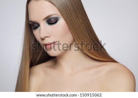 Portrait of young beautiful woman with long fair hair and stylish make-up