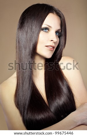 Portrait of young beautiful woman with long glossy hair - stock photo