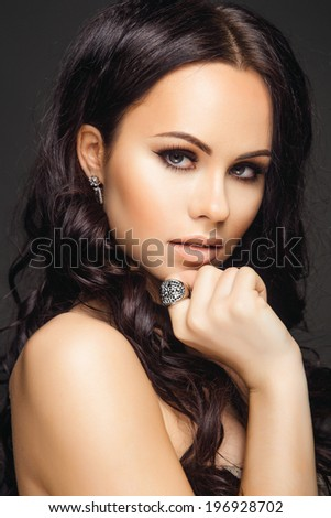 Portrait of Young Beautiful Woman with Long Hair, Clean Skin and Jewelry