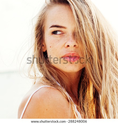 Portrait Of Young Beautiful Woman with Long Hair, Looking to the Right - stock photo