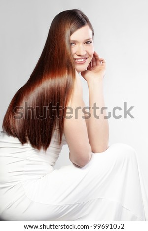 Portrait of young beautiful woman with perfect hair - stock photo
