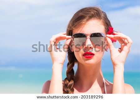 portrait of young beautiful woman with red lips and hibiscus, - stock photo