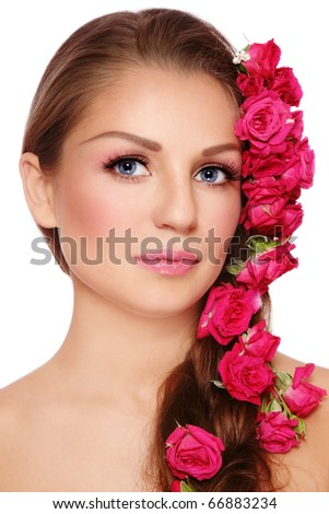 Portrait of young beautiful woman with rose in hair, on white background - stock photo