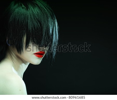 Portrait of young beautiful woman with short dark hair - stock photo