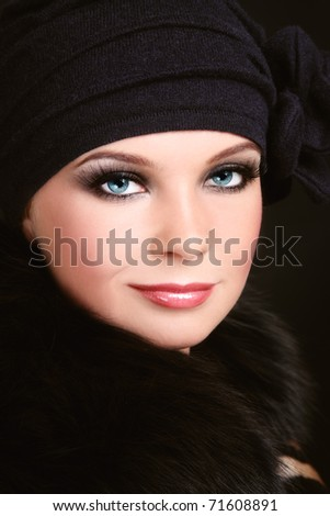 Portrait of young beautiful woman with smoky eyes - stock photo