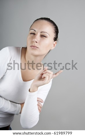 Portrait of young beautiful woman with stern look - stock photo