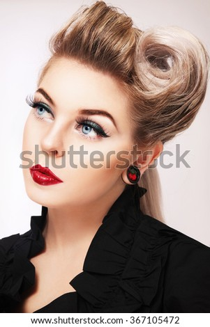 Portrait of young beautiful woman with stylish make-up and fancy hairdo - stock photo