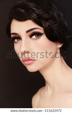 Portrait of young beautiful woman with stylish make-up and hairdo - stock photo