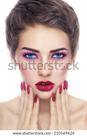 Portrait of young beautiful woman with stylish make-up and long nails over white background - stock photo