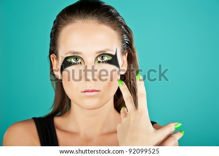 Portrait of young beautiful woman with stylish make-up. isolate on green background