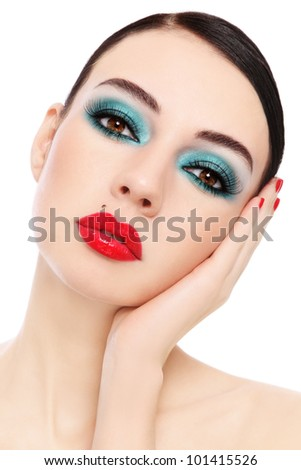 Portrait of young beautiful woman with stylish make-up over white background