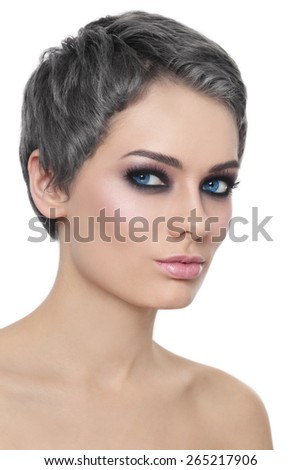 Portrait of young beautiful woman with trendy grey hair and stylish haircut over white background - stock photo