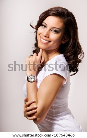 Portrait of young beautiful woman with watch on white background. - stock photo